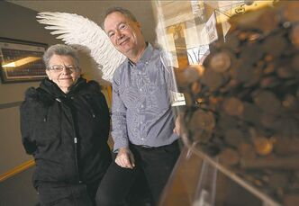 Trevor Hagan / Winnipeg Free Press Olive Fontaine with Free Press' Pennies for Heaven campaign spokesman Kevin Rollason.