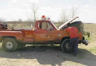 Crews scramble to fix the fire truck Friday at Brokenhead.