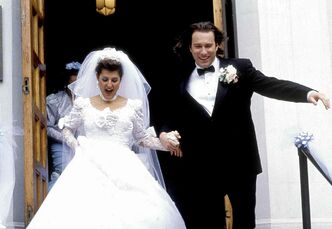 Nia Vardalos and John Corbett tie the knot in My Big Fat Greek Wedding.