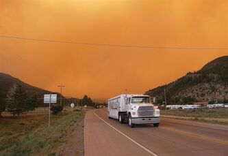 Smoke from the West Fork Fire surrounds drivers on Colorado 149 near South Fork, Colo. Thursday, June 20, 2013. The highway was later closed and mandatory evacuation orders issued for the nearby town of South Fork. (AP Photo/The Pueblo Chieftain, Matt Hildner)