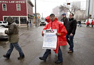 Alberta sheriffs take to the streets and join correction guards, setting up a picket line outside the Edmonton courthouse in Edmonton, Alberta on Monday April 29, 2013. THE CANADIAN PRESS/Jason Franson