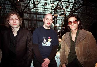 Kevin Young (left), Paul Wilcox and David Usher (right) of the group Moist attend a reception prior to the Juno Awards in Toronto March 11, 2000.