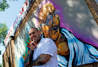 Artist Brian Gasenzer says he is heavily inspired by Indian culture and spirituality, which is reflected in his new mural on the side of India Palace.