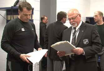 Off-ice officials work behind the scenes at games.
