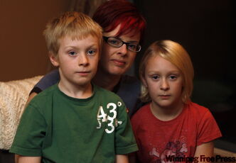 'I'm more concerned about them getting severe H1N1 than I'm concerned about vaccine side-effects. It's pretty awful' --  Jennifer Dunsford plans to be in line today with her children Jack and Aimee