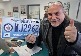 Sal Garofoli was one of the first customers this morning to pick up his custom Winnipeg Jets license plate at Saper Agencies.