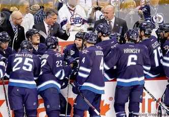 Winnipeg Jets head coach Claude Noel tries to rally the troops Sunday during the Jets' 5-1 loss to the Montreal Canadiens at MTS Centre.