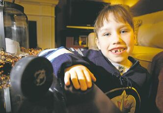 Eight-year-old Abby Reid with her prize puck possession, courtesy Jets defenceman Zach Bogosian.