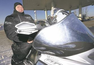 LEFT: Darren Jackson makes a pit stop at the 59er � a popular spot for snowmobilers.