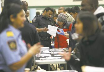 Close to 1,000 people attend the Afro-Caribbean Job Fair in the Elmwood High School gymnasium on Saturday. Jim Ogunnoiki, originally from Nigeria, started it 14 years ago out of his house to help people find work.