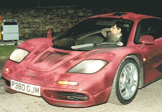 Photo dated Nov. 15 1998 of comedian Rowan Atkinson at the wheel of his McLaren F1 sports car. It was reported Friday Feb. 8 2013 that it took more than a year � and more than 900,000 pounds ($1,400,000) � to get his supercar up and running after a 2011 crash in which he badly injured a shoulder, but F1's now sell for around 3.5 million pounds. The car makes extensive use of carbon fiber and needed specialist care. The car insurance settlement is one of the largest in British history. (AP Photo/Barry Batchelor/PA) UNITED KINGDOM OUT NO SALES NO ARCHIVE