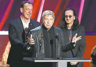 Alex Lifeson, center, Neil Peart, left, and Geddy Lee, right, of Rush.