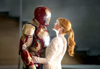Robert Downey Jr., left, as Tony Stark/Iron Man and Gwyneth Paltrow as Pepper Potts in