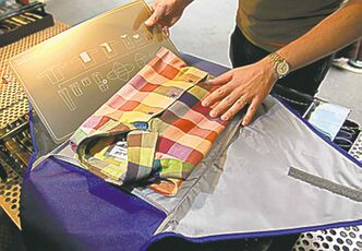 Fashion. Threads. At  Hanford Drewitt, Jon Thiessen of UN Luggage, demonstrates how to travel light. Packing a Pack-It Folder 18.   Wayne Glowacki / Winnipeg Free Press Oct. 22 2013