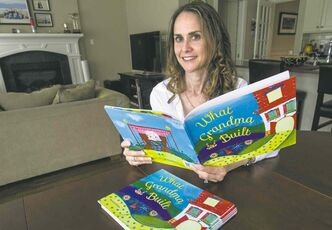 Michelle Gilman with her children's book, What Grandma Built.