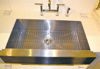 Stainless-steel apron sink with bottom rack sells for about $1,000 at The Ensuite.