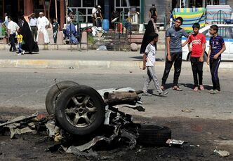 People inspect the site of a car bomb attack in Sadr City, Baghdad, Iraq, Wednesday, Aug. 28, 2013. A coordinated wave of bombings tore through Shiite Muslim areas in and around the Iraqi capital early Wednesday, killing scores and wounding many more, officials said. The blasts, which came in quick succession, targeted residents out shopping and on their way to work. (AP Photo/Khalid Mohammed)
