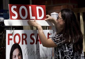 "A real estate agent puts up a ""sold"" sign in front of a house in Toronto Tuesday, April 20, 2010. First-time homebuyers shopping for a mortgage have all the technology at their fingertips to make informed decisions, and financial experts say those resources should arm them with enough knowledge to prepare themselves and even negotiate a better rate. THE CANADIAN PRESS/Darren Calabrese"