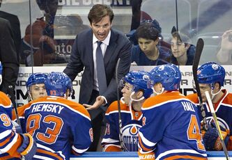 Edmonton Oilers head coach Dallas Eakins talks to his players while playing the New York Rangers during third period NHL pre-season hockey action in Edmonton, Alta., on Tuesday September 24, 2013. THE CANADIAN PRESS/Jason Franson