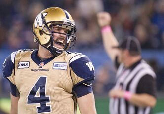 Winnipeg Blue Bombers quarterback Buck Pierce reacts after a play while playing against the Toronto Argonauts during second half CFL football action in Toronto on Friday, Oct. 19, 2012.