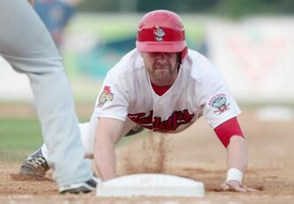 Josh Mazzola was safe at base during a game against St. Paul Saints  Saturday evening.