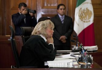 Supreme Court Justice Minister Olga Sanchez listens during a panel hearing reviewing the case of Frenchwoman Florence Cassez in Mexico City, Wednesday, Jan. 23, 2013. The Mexican Supreme Court panel voted Wednesday to release Cassez, who was sentenced to 60 years in prison for kidnapping. Cassez was arrested in 2005 and convicted of helping her Mexican then-boyfriend run a kidnap gang. The five-justice panel voted 3-2 to order Cassez released because of procedural and rights violations during her arrest. (AP Photo/Eduardo Verdugo)