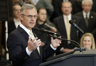 Former Ohio State football coach Jim Tressel speaks after being introduced as the new vice president for strategic engagement at the University of Akron Thursday, Feb. 2, 2012, in Akron, Oho. (AP Photo/Mark Duncan)