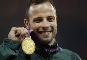 Oscar Pistorius with gold medal from the 2012 Paralympics, in London.