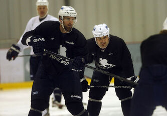 NHL and Winnipeg Jets players continue to stay in shape at the MTS Iceplex as they continue to wait for a labour-management solution to the NHL lockout. Jets players Andrew Ladd (left) and Mark Stuart  at practice wearing NHLPA jerseys.