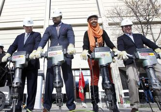 U of M president David Barnard, (left), Israel Idonije, Bilan Arte, U of M Student Union president and David Asper took part in the official ground-breaking ceremony today.