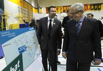 Premier Greg Selinger (right) and Dave Gaudreau, MLA for St. Norbert, at Bairdmore Elementary School Tuesday for the announcement that the Manitoba government plans to build a new school in the South Pointe area of Waverley West.