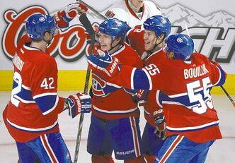 Habs' Brendan Gallagher (centre) celebrates with teammates after scoring against the Ottawa Senators Friday night in Montreal.