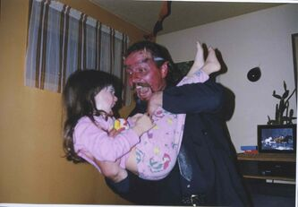 Andrew Baryluk, seen in a photo with his niece in the 1990s, loved to dress up on Halloween, his family remembers.
