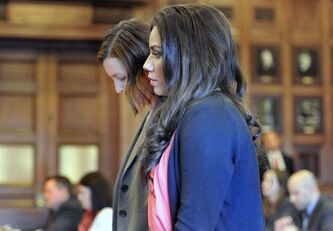 Alexis Wright appears with her attorney, Sarah Churchill, Friday, March 29, 2013 in Cumberland County Court, in Portland, Maine. Wright, a dance instructor accused of using her Zumba fitness studio as a front for prostitution pleaded guilty Friday to 20 counts in a scandal that captivated a quiet seaside town. (AP Photo/Portland Press Herald, John Ewing, Pool)