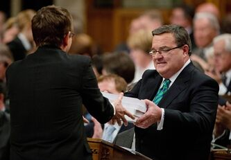 Finance Minister Jim Flaherty tables the federal budget in the House of Commons on Parliament Hill in Ottawa on Thursday March 21, 2013. THE CANADIAN PRESS/Adrian Wyld