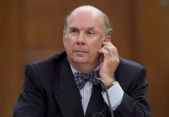 Justice Marc Nadon listens to opening remarks as he appears before a parliamentary committee following his nomination to the Supreme Court of Canada Wednesday October 2, 2013 on Parliament Hill in Ottawa. The Supreme Court of Canada is set to begin grappling with an extraordinary first in its 139-year history: adjudicating the rules for the appointment of one of its own.The eight sitting justices hear arguments Wednesday morning concerning the eligibility of Nadon, the latest appointment by Prime Minister Stephen Harper to the top court. THE CANADIAN PRESS/Adrian Wyld