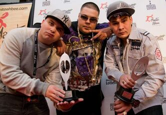 Local hip-hop group Winnipeg's Most pose on the red carpet with two Aboriginal People's Choice Music Awards in 2010. William Pierson/Jon-C (centre) had his home raided by police in 2008 and the case is finally in court. Jawards from Thursday night, Best Rap/Hip Hop CD, and Best Duoor Group, prior to the Aboriginal People's Choice Music Awards Friday night at the MTS Centre as part of the annual Manito Ahbee festival.