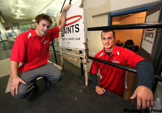 Winnipeg Saints Brett Chartier (left) and Jeff Mitchell pose at the team's new quarters in the St. James Civic Centre on Thursday.