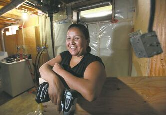 Deloraine Houle is getting on-the-job training through BUILD, which steers men and women into the building trades.
