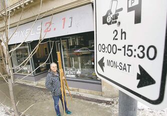 Joe Kerr, owner of Pixels 2.1, says the parking-fee hike was the 'straw that broke the camel's back' for his gallery.