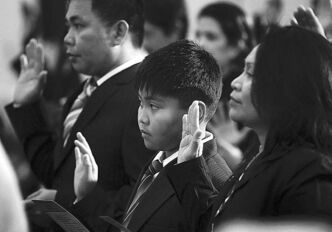 New citizens are sworn in at the Manitoba legislature in February 2012.