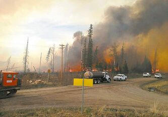 Firefighting crews at the scene of a wildfire near Nordegg, Alta.