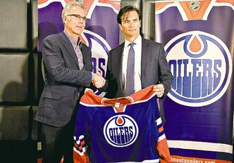 Edmonton Oilers GM Craig MacTavish (left) told his players Thursday they're on the right track and ensured them he's committed to coach Dallas Eakins (right).