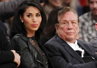 Los Angeles Clippers owner Donald Sterling, right, and V. Stiviano, left, watch the Clippers play the Los Angeles Lakers during an NBA preseason basketball game in Los Angeles. NBA Commissioner Adam Silver is intent on moving quickly in dealing with the racially charged scandal surrounding Clippers owner Sterling.