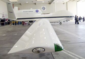 File-This April 13,2010 file photo shows a NASA Global Hawk robotic jet siting in a hangar at Dryden Flight Research Center in Edwards Air Force Base, Calif. The Federal Aviation Administration is looking for six sites to test drones before they are integrated into the civilian airspace. Fifty teams from 39 states have applied for the chance to boost their economies. (AP Photo/John Antczak,File)