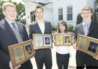 Andrew Kochan, Yale Michaels, Teslyn Anderson and Jordan Hurton with their scholar/athlete awards.