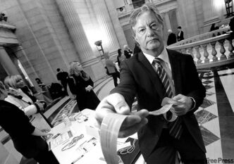 "Michael Cloutier, president and CEO of the Canadian Diabetes Association, stretches out a tape measure used to determine body mass index (BMI), a key factor in diabetes risk. Cloutier was at the Manitoba Legislature to give a ""frank warning"" to MLAs about the growing diabetes epidemic."
