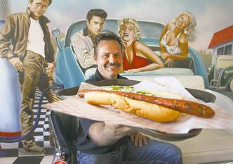 Out of this world: Wayne McIntosh of the Half Moon Drive In holds up the delicacy his diner is famous for.