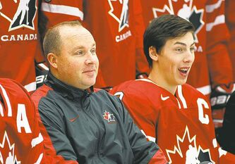Head coach Steve Spott and team captain Ryan Nugent-Hopkins yuk it up Friday.