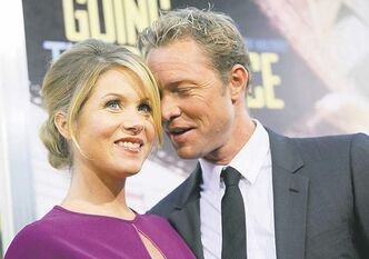 "Christina Applegate, left, a cast member in ""Going the Distance,"" is joined by her fiance' Martyn LeNoble at the premiere of the film, Monday, Aug. 23, 2010, in Los Angeles. (AP Photo/Chris Pizzello)"